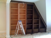 Wood bookshelf half stained